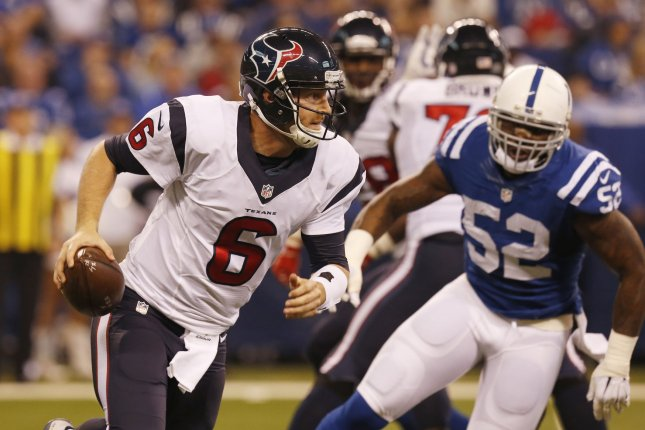 Houston Texans quarterback T.J. Yates (6) runs under pressure from the Indianapolis Colts D'Qwell Jackson (52) during the first half of play at Lucas Oil Stadium in Indianapolis, Indiana, December 20, 2015. File photo by John Sommers II/UPI