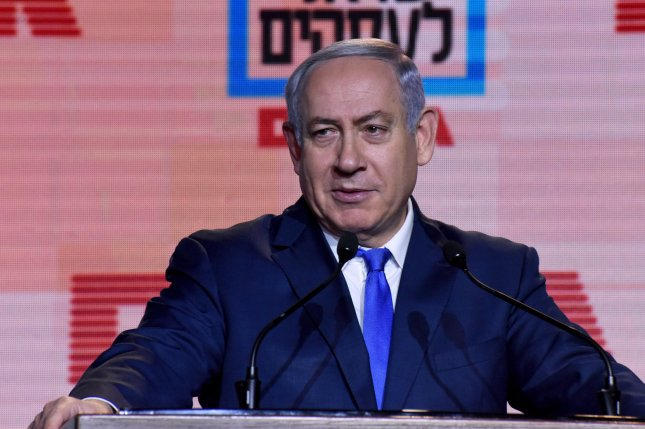 Israeli Prime Minister Benjamin Netanyahu speaks at a business conference in Jerusalem on January 11. Israel's police are recommending that he should be indicted in two corruption cases. Photo by Debbie Hill/UPI