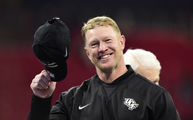 Former Central Florida coach Scott Frost tips his cap after his team won in the Peach Bowl to go undfeated. Photo by David Tulis/UPI