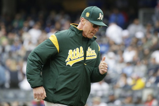 cheap for discount 50b27 539e8 Oakland A's one win away from popping corks on wild-card ...