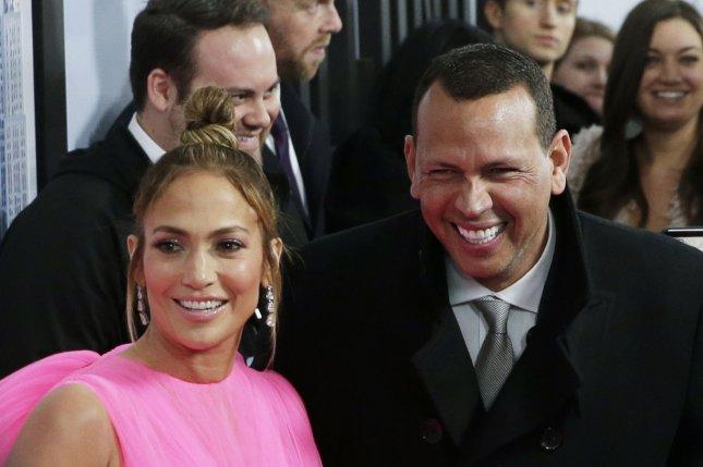 Jennifer Lopez (L), pictured with Alex Rodriguez, released a video for Limitless, her song for the movie Second Act, featuring daughter Emme on Thursday. File Photo by John Angelillo/UPI