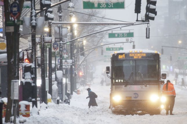 Snow piles up on Sixth Avenue in New York City on Monday after a nor'easter arrived and produced more than 2 feet of snow in some locations. Photo by John Angelillo/UPI