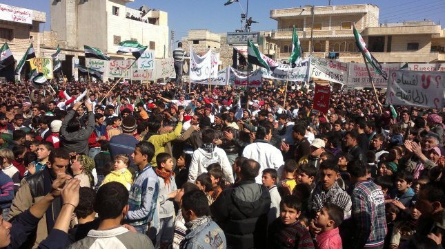 Demonstrators take part in a angry protest against Syria's President Bashar Assad after Friday prayers in Binsh near Idlib on Feb. 24, 2012. UPI
