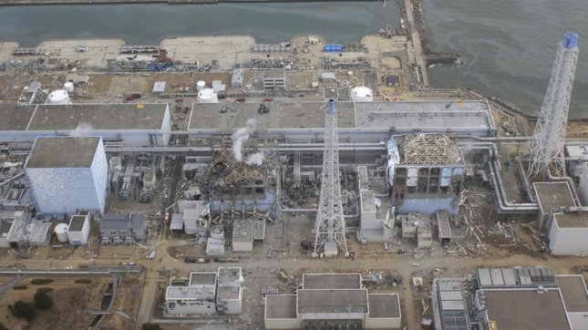 The crippled Fukushima Dai-ichi nuclear power plant is seen in Okumamachi, Fukushima prefecture, northern Japan in this March 20, 2011 aerial photo taken by a small unmanned drone and released by AIR PHOTO SERVICE. From left: Unit 1, partially seen; Unit 2, Unit 3 and Unit 4. UPI/Air Photo Service Co. Ltd.