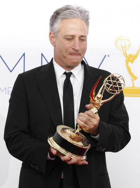 Jon Stewart appears backstage with his Emmy at the 64th Primetime Emmy Awards in 2012. File Photo by Danny Moloshok/UPI