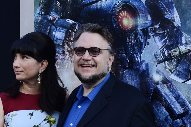 Director Guillermo del Toro and his wife Lorenza Newton attend the premiere of his new sci-fi motion picture Pacific Rim, at the Dolby Theatre in the Hollywood section of Los Angeles on July 9, 2013. Del Toro will not be showing his 'Crimson Peak' at the Venice Film Festival this year. File Photo by Jim Ruymen/UPI