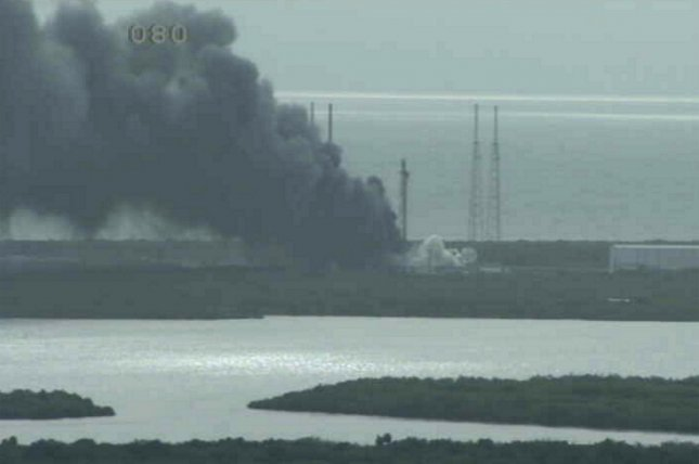 A still image from NASA video shows heavy smoke billowing at Cape Canaveral, Fla., after a SpaceX Falcon 9 rocket exploded at Space Launch Complex 40 on September 1. The rocket exploded during a static testing of its engines and destroyed a $95 million communications satellite owned by Facebook. Friday, SpaceX said the accident may have resulted from a breach in the cryogenic helium system. Photo by NASA/UPI
