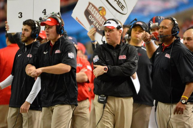 Former Mississippi head coach Hugh Freeze (C) calls in a play against TCU during the second half of their Chick-fil-A Peach Bowl game at the Georgia Dome on December 31, 2014, in Atlanta. Freeze is no longer the head coach of the Rebels following an incident linked to his phone and an escort service. File photo by David Tulis/UPI