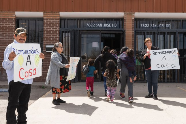 Volunteers at Caminos de Vida in El Paso, Texas, welcome migrants released from ICE custody in March. File Photo by Justin Hamel/UPI