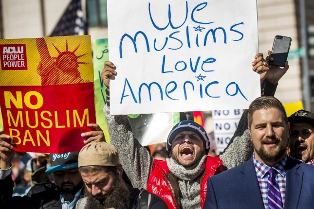 Activists attend a #NoMuslimBanEver rally in Lafayette Park in front of the White House on October 18, 2017 sponsored by The Council on American-Islamic Relations. File Photo by Pete Marovich/UPI