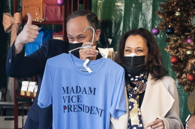 Vice President-elect Kamala Harris and her husband Doug Emhoff buy a shirt that reads, Madam Vice President on it at the Downtown Holiday Market on small business Saturday. Photo by Kevin Dietsch/UPI