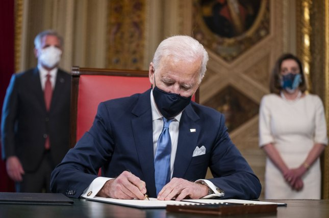 President Joe Biden signs three documents including an inauguration declaration, cabinet nominations and sub-cabinet nominations in the Presidents Room at the U.S. Capitol in Washington, D.C., after the inauguration ceremony on Wednesday. Pool Photo by Jim Lo Scalzo/UPI