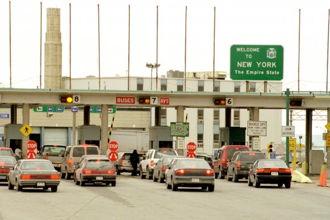 Cars from Canada entering the United States at the Peace Bridge near Buffalo, N.Y. On Friday, the Biden administration said it would keep borders closed to international traffic. File Photo by Gary Wiepert/UPI