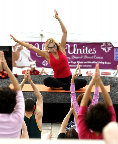 Jennifer Schelter (center) leads some 600 breast cancer survivors and their families through yoga exercises on the steps of the Philadelphia Art Museum in downtown Philadelphia May 20, 2007. They participate in the the mass yoga class annually to raise funds and awareness of breast cancer issues. (UPI Photo/John Anderson)