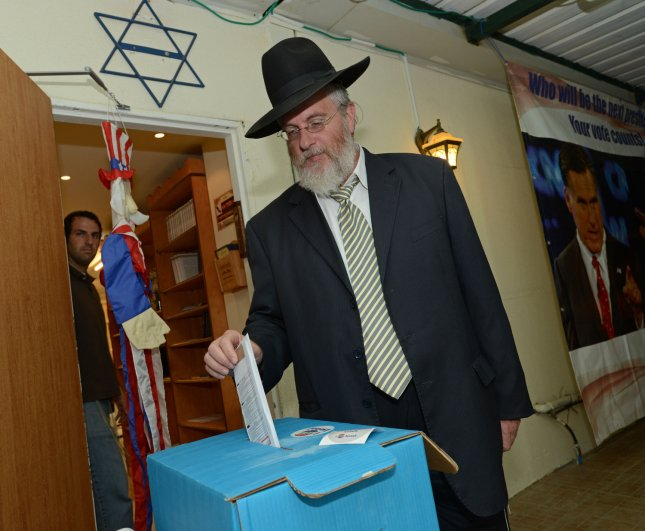 An American Israeli cast his absentee ballot for the USA elections at a temporary polling station in a synagogue, set up by the organization I Vote Israel, in Ramat Bet Shemesh, Israel, October 22, 2012. UPI/Debbie Hill