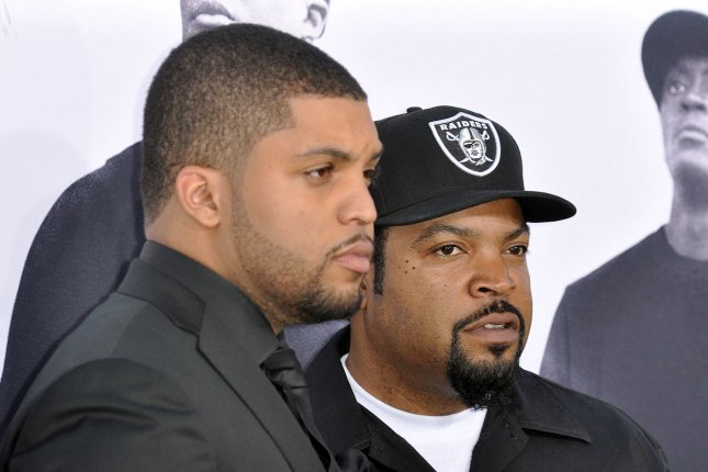 Cast member O'Shea Jackson Jr. (L) and his father Ice Cube attend the premiere of the N.W.A. motion picture biopic Straight Outta Compton at Microsoft Theater in Los Angeles on Aug. 10, 2015. Photo by Christine Chew/UPI