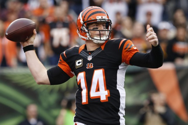 Cincinnati Bengals quarterback Andy Dalton (14) throws under pressure from the Pittsburgh Steelers defense during the first half of play at Paul Brown Stadium in Cincinnati, Ohio, December, 2015. Photo by John Sommers II/UPI
