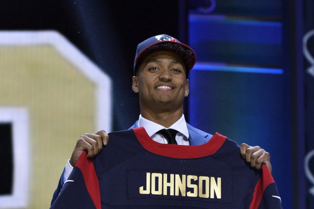 Wake Forest's Kevin Johnson holds his jersey after he was selected 16th overall by the Houston Texans during the first round of the NFL Draft on April 30, 2015 in Chicago. Photo by Brian Kersey/UPI
