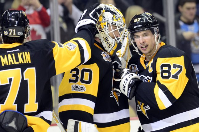 Pittsburgh Penguins center Sidney Crosby (87) joins Pittsburgh Penguins center Evgeni Malkin (71) in congratulating Pittsburgh Penguins goalie Matt Murray (30) following the Penguins 4-0 win at the PPG Paints Arena in Pittsburgh on February 14, 2017. Photo by Archie Carpenter/UPI
