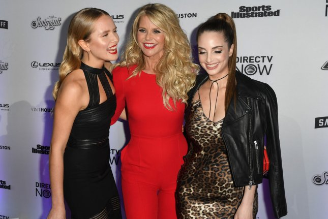 Christie Brinkley (C) with daughters Sailor Brinkley Cook (L) and Alexa Ray Joel at the 2017 Sports Illustrated swimsuit issue launch on Thursday. Photo by Andrea Hanks/UPI