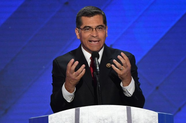 California Attorney General Xavier Becerra addresses delegates on Day 4 of the Democratic National Convention at Wells Fargo Center in Philadelphia on July 28. He announced California will no longer use taxpayer money for state employee travel to four states over LGBT discrimination. File Photo by Pat Benic/UPI