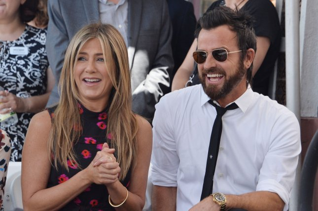 Justin Theroux (R) and Jennifer Aniston attend Jason Bateman's Hollywood Walk of Fame ceremony on July 26. The actor discussed the comedy one-upmanship he has with Aniston in a new interview. File Photo by Jim Ruymen/UPI