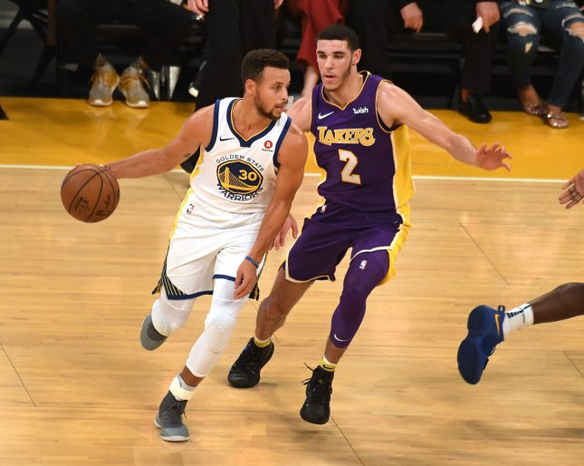 Golden State Warriors guard Steph Curry drives by Los Angeles Lakers guard Lonzo Ball during their game at the Staples Center in LA last month. Photo by Jon SooHoo/UPI