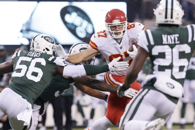 Kansas City Chiefs tight end Travis Kelce runs with the football in the 4th quarter against the New York Jets on December 3 at MetLife Stadium in East Rutherford, N.J. Photo by John Angelillo/UPI