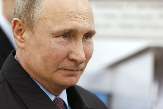 Putin appeals to 'love of fatherland' to get Russians to polls