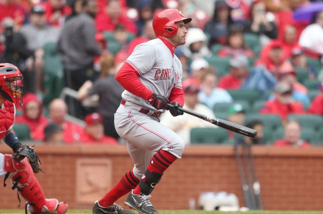 Cincinnati Reds' Joey Votto swings hitting a RBI single in the sixth inning against the St. Louis Cardinals on April 22 at Busch Stadium in St. Louis, Mo. Photo by Bill Greenblatt/UPI