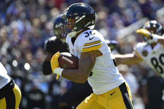 f551ff0d14d Pittsburgh Steelers running back James Conner (30) runs for a first down  against the Baltimore Ravens on October 1