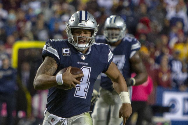 Dallas Cowboys quarterback Dak Prescott (4) runs the ball against the Washington Redskins in the second half of play on October 21, 2018 at FedEx Field in Landover, Maryland. Photo by Tasos Katopodis/UPI