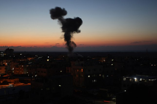Smoke rises following Israeli airstrikes in the southern Gaza Strip city of Rafah on Monday. Photo by Ismael Mohamad/UPI