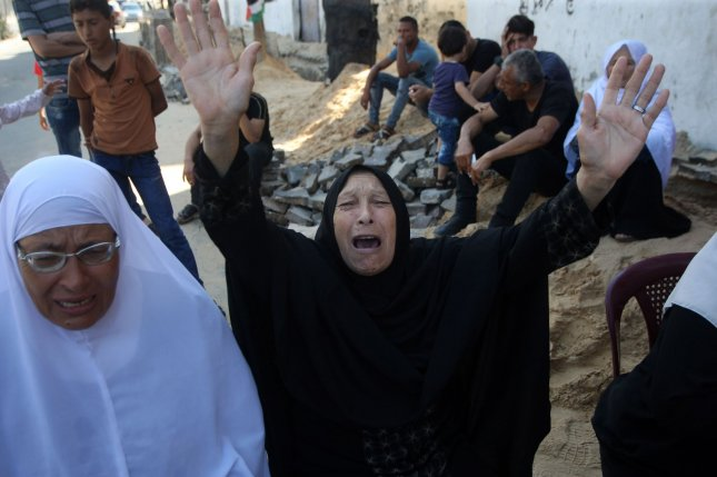 A Palestinian relative of Saher Othman, 20, mourns during his funeral in Rafah in the southern Gaza Strip on Saturday. Photo by Ismael Mohamad/UPI