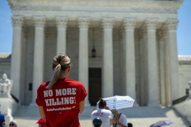 Opponents of capital punishment gather outside the U.S. Supreme Court in Washington, D.C., on Tuesday to mark the anniversaries of two related decisions concerning the death penalty. Thursday, the court finishes its term and won't return until the October term. Photo by Bonnie Cash/UPI