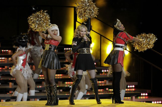 Madonna (C) performs with Nicki Minaj (L) and M.I.A during the Halftime Show at Super Bowl XLVI between the New York Giants and the New England Patriots at Lucas Oil Stadium for NFL in Indianapolis, Indiana on February 5, 2012. UPI/John Angellilo