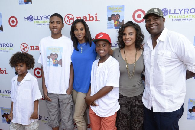 Holly Robinson Peete (3rd L) with (L-R) sons R.J., Roman, Robinson, daughter Ryan and husband Rodney Peete attend the HollyRod Foundation's 4th annual My Brother Charlie Carnival to benefit families with autism held at Culver Studios in Los Angeles on August 3, 2013. UPI/Phil McCarten