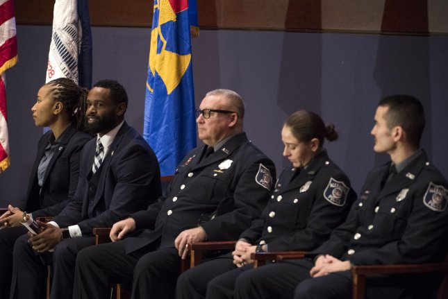 From left to right, Capitol Police Special Agents David Bailey and Crystal Griner and Alexandria, Va., police officers Nicole Battaglia, Alexander Jensen and Kevin Jobe attend their Capitol Police Medal of Honor Ceremony on Thursday. Photo by Kevin Dietsch/UPI