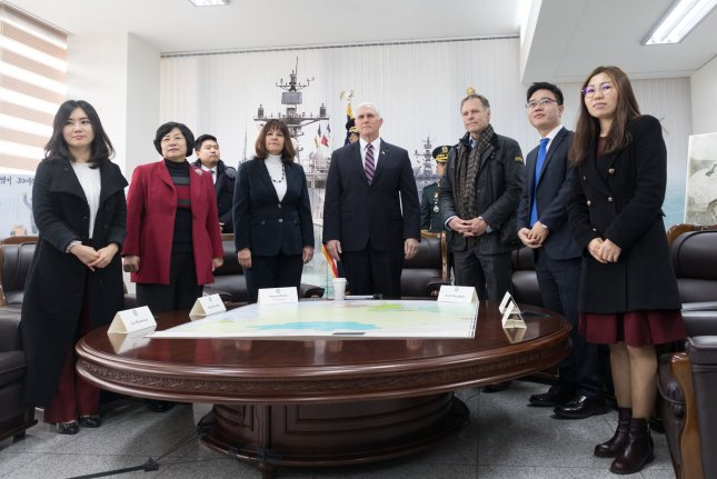 Vice President Mike Pence, accompanied by his wife Karen Pence and Fred Warmbier, father of Otto Warmbier, the American who died following his release from North Korean captivity last year, meet with North Korean defectors at the Cheonan Memorial in 2018,in South Korea. File Photo by D. Myles Cullen/White House