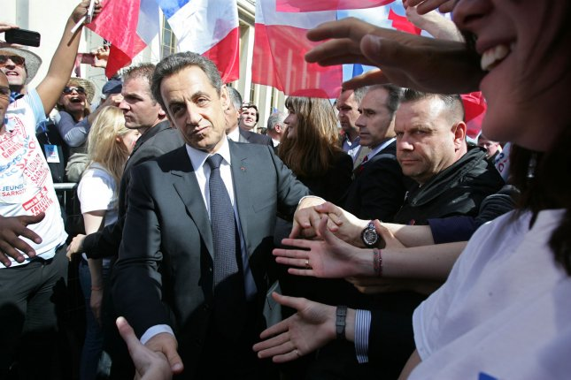 French incumbent President Nicolas Sarkozy shakes hands during a party rally on May Day ahead of the second round of votes for the presidential elections in Paris, France, on May 1, 2012. Sarkozy is to face of his socialist rival Francois Hollande tomorrow during a TV debate. UPI/Eco Clement