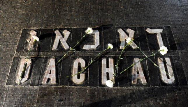 White carnations are placed on the name of the Dachau concentration camp on Holocaust Remembrance Day at the Yad Vashem Holocaust Memorial in Jerusalem, April 12, 2010. File Photo by Debbie Hill/UPI