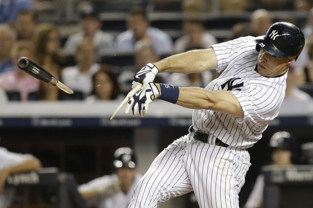 New York Yankees Mark Teixeira hits a broken bat single in the 9th inning against the Boston Red Sox at Yankee Stadium in New York City on August 5, 2015. The Red Sox defeated the Yankees 2-1. Photo by John Angelillo/UPI