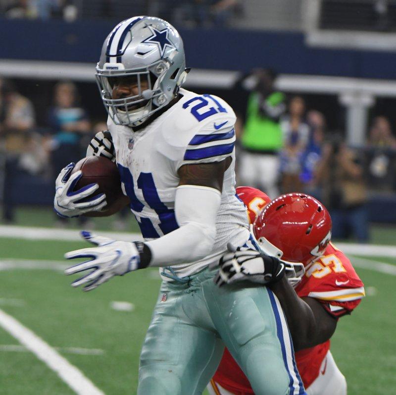 Dallas Cowboys running back Ezekiel Ellott rushes against the Kansas City Chiefs in November. Photo by Ian Halperin/UPI
