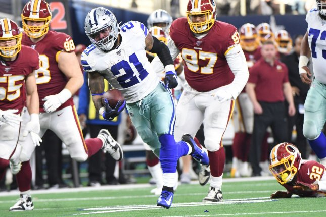 Dallas Cowboys running back Ezekiel Elliott (21) had a rushing score and a receiving score in a win over the Washington Redskins on Sunday in Arlington, Texas. Photo by Ian Halperin/UPI