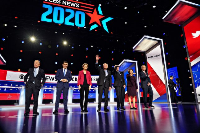 The seven Democratic candidates in the CBS News Democratic Debate stand together at the start of the event at the Gaillard Center on Tuesday in Charleston, S.C.: Fom left to right, Michael Bloomberg, Pete Buttigieg, Elizabeth Warren, Bernie Sanders, Joe Biden, Amy Klobuchar, and Tom Steyer. Photo by Richard Ellis/UPI