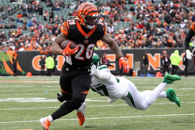 Cincinnati Bengals running back Joe Mixon (28) breaks free from New York Jets defender Maurice Canada (37) during a game at Paul Brown Stadium in Cincinnati, Ohio, on December 1, 2019. File Photo by John Sommers II/UPI