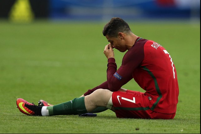 Cristiano Ronaldo of Portugal lies injured during the Euro 2016 Final match at the Stade de France in Paris, France on July 10, 2016. Portugal won the match 1-0 after extra-time to secure their first European Championship. Photo by Chris Brunskill/UPI