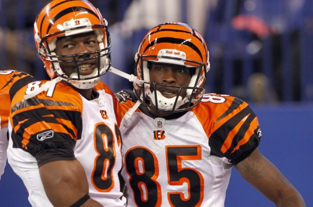 Former Cincinnati Bengals wide receiver Chad Ochocinco (85) is congratulated by teammate Terrell Owens (81) after scoring a touchdown during in 2010 at Lucas Oil Field in Indianapolis, Ind. File photo by Mark Cowan/UPI