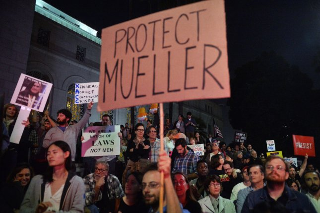 Activists demand protection for Special Counsel Robert Mueller during a protest in Los Angeles Thursday.