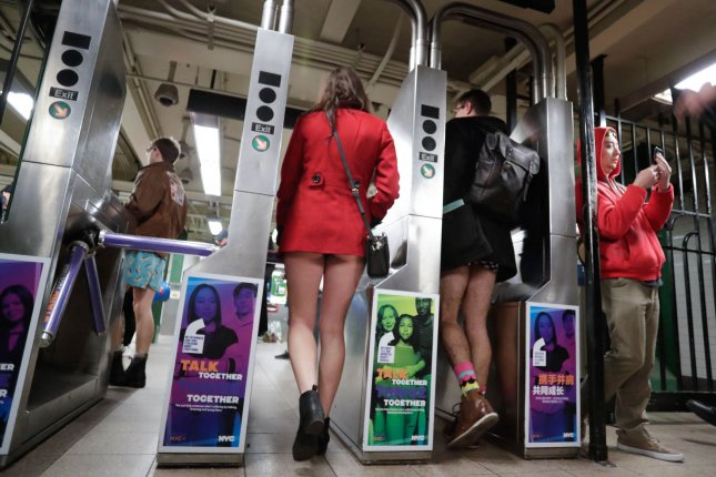 Men and women walk in the subway wearing no pants when they participate in the 18th annual No Pants Subway Ride in New York City on Sunday. Similar rides and events were held on the same day in cities around the world. Photo by John Angelillo/UPI